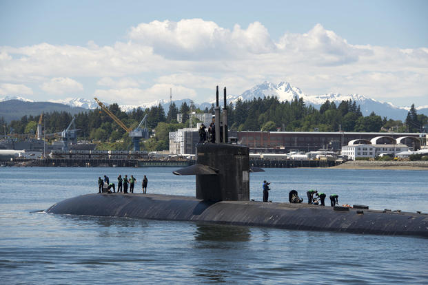 The Los Angeles-class fast-attack submarine USS Buffalo (SSN 715) arrives at Naval Base Kitsap-Bremerton to commence its inactivation process after 33 years of service, May 26, 2017. (U.S. Navy photo/Mass Communication Specialist 1st Class Amanda R. Gray)