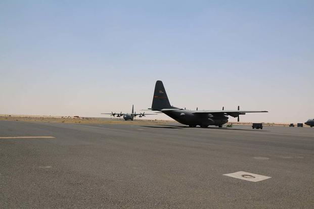 SOUTHWEST ASIA - C-130s, a part of the 386th Air Expeditionary Wing, taxi on the runway. The Hercules' average around 500 sorties, deliver thousands of tons, and transport 9,000 people a month. (Photo: Oriana Pawlyk)