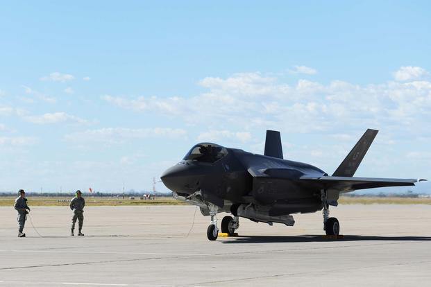 Brig. Gen. Scott Pleus, the 56th Fighter Wing commander, lands the flagship F-35 Lightning ll at Luke Air Force Base, Ariz., April 28, 2015. (U.S. Air Force photo/Senior Airman Devante Williams)