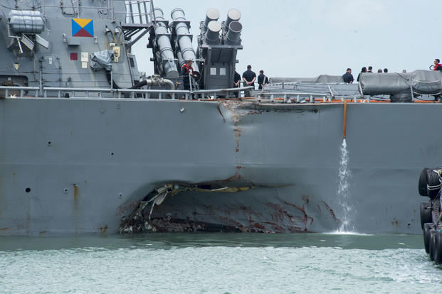 Damage to the portside is visible as the Guided-missile destroyer USS John S. McCain steers towards Changi Naval Base, Republic of Singapore, following a collision with the merchant vessel Alnic MC on Aug. 21, 2017. (U.S. Navy photo/Joshua Fulton)
