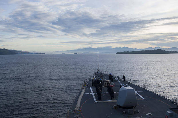 The Arleigh Burke-class guided-missile destroyer USS John S. McCain transits into Subic Bay, Republic of the Philippines to refuel and resupply. (U.S. Navy photo/Mass Communication Specialist 3rd Class Joshua Mortensen)