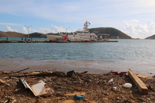 In response to Hurricane Irma, members of the U.S. Coast Guard transport supplies and provide medical services to St. Thomas, VI, September 10, 2017. (U.S. Army National Guard photo/Army Sgt. Priscilla Desormeaux)