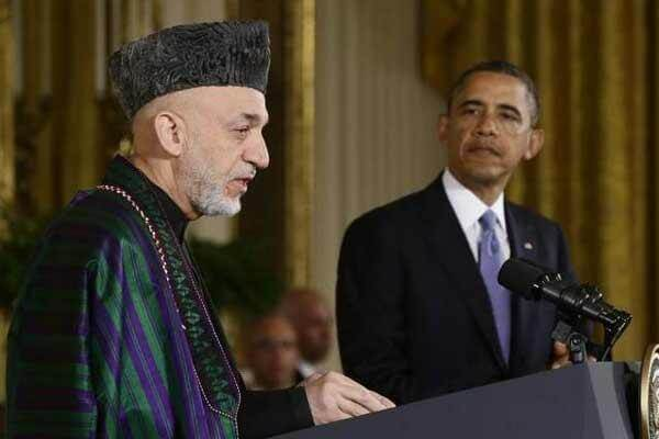 President Barack Obama listens as Afghan President Hamid Karzai speaks during a news conference in the East Room at the White House in Washington, Friday, Jan. 11, 2013. (AP Photo/Charles Dharapak)