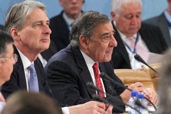 U.S. Secretary of Defense Leon Panetta, right, and Britain's Secretary of State for Defense Philip Hammond attend the two-day NATO defense ministers meeting to discuss Syria and Afghanistan, at NATO headquarters in Brussels.