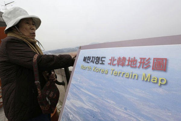 A visitor looks at North Korean territory.