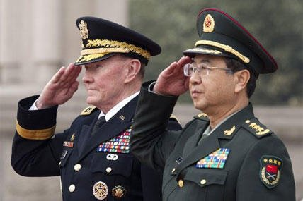 Joint Chiefs Chairman Gen. Martin Dempsey, left, and Chinese counterpart Gen. Fang Fenghui salute during a welcoming ceremony at the Bayi Building in Beijing, China Monday, April 22, 2013.