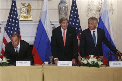 Secretary of State John Kerry, center, Defense Secretary Chuck Hagel, right, and Russian Foreign Minister Sergei Lavrov take their seats before making statements to reporters as they meet at the State Department in Washington, Friday, Aug. 9, 2013.