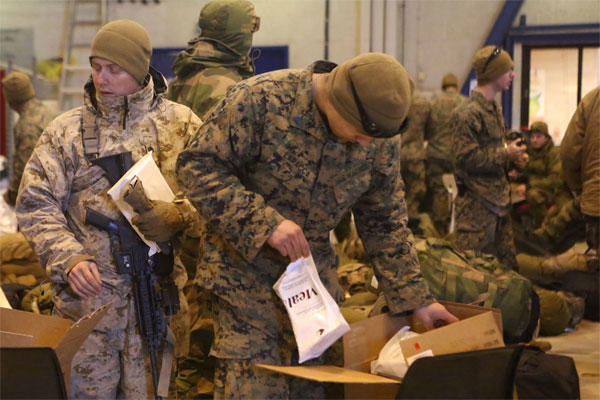 Marines with 2nd Supply Battalion, Combat Logistics Regiment 25, 2nd Marine Logistics Group take Meals, Cold Weather during the drawdown of Cold Response 14 at Evenes, Norway, March 19, 2014.