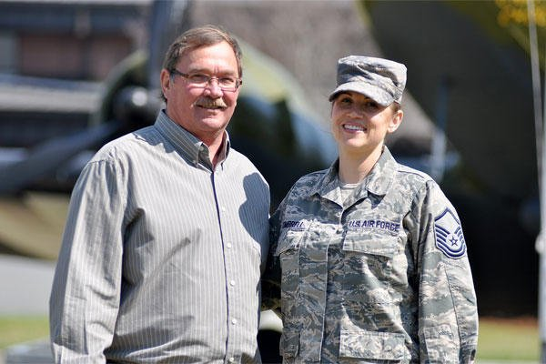 Air Force Reserve Master Sgt. Stephanie Kimbrell stands with David Harvill for a photo at Joint Base Charleston, S.C., March 24, 2014.