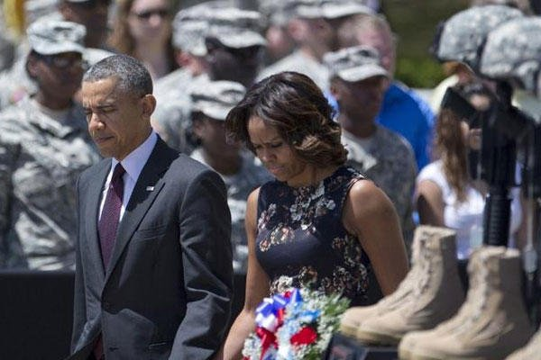 President Barack Obama and first lady Michelle Obama arrive for a memorial ceremony, Wednesday, April 9, 2014, at Fort Hood Texas, for those killed there in a shooting last week. (AP Photo/Carolyn Kaster)