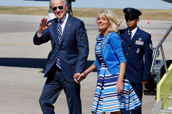 Vice President Joe Biden, left, walks from Air Force Two with his wife Jill Biden, upon arrival at Denver International Airport, Tuesday May 27, 2014, in Denver.