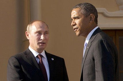 In this Sept. 5, 2013 file photo, President Barack Obama shakes hands with Russian President Vladimir Putin during arrivals for the G-20 summit at the Konstantin Palace in St. Petersburg, Russia, Thursday, Sept. 5, 2013.