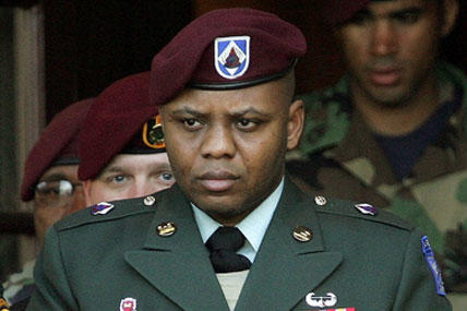 Sgt. Hasan Akbar is led from the Staff Judge Advocate Building at Fort Bragg, N.C., during the sentencing phase of his court-martial, on April 25, 2005. (AP)