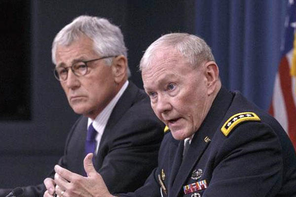 Joint Chiefs Chairman Gen. Dempsey, accompanied by Defense Secretary Hagel, brief reporters about ongoing operations against Islamic extremists in Syria and Iraq at the Pentagon, Friday, Sept. 26, 2014 (AP Photo/J. Scott Applewhite)