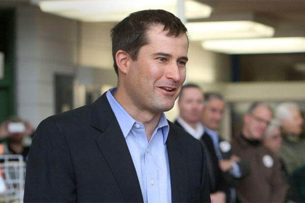 This March 1, 2014 photo shows Seth Moulton, 35, speaking at a Democratic caucus in the library of Salem High School in Salem, Mass. (AP)