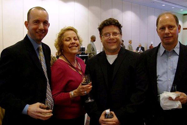 Former Wounded Warrior Care and Transition Policy's Principal Director Philip Burdette (left) is seen here standing for a photo with other Pentagon officials and actor Sean Astin at the Care Coordination Summit in 2011. DoD photo