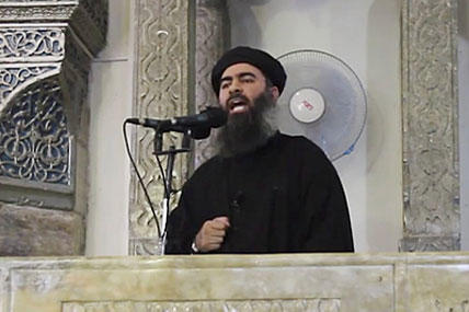 This image made from video posted on a militant website in July 2014, which has been authenticated based on its contents and  reporting, shows the leader of the Islamic State group, Abu Bakr al-Baghdadi, delivering a sermon at a mosque in Iraq. AP photo