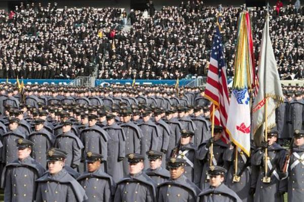 The Cadets and Midshipmen march onto the field in the annual tradition ahead of the Army-Navy game. (DoD photo)