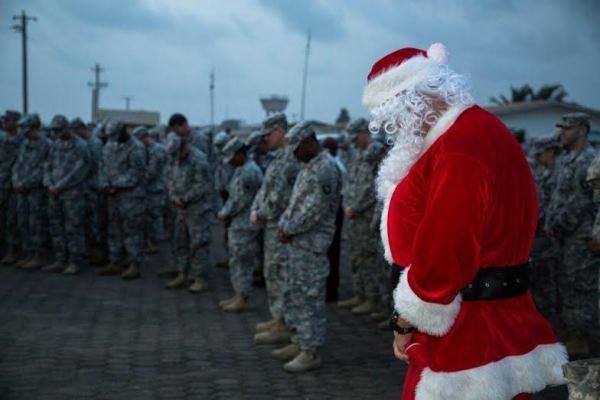 Soldiers deployed to Liberia bow their head ahead of the Christmas holiday. (U.S. Army photo)