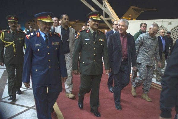 Secretary of Defense Chuck Hagel walks with Lt Gen. Mohammad Al Khoder, Kuwait Army Chief of Staff as the secretary arrives at the Kuwait International Airport , Dec. 7, 2014. (Adrian Cadiz/U.S. Air Force)