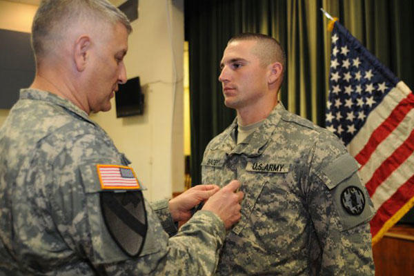 Sgt. Maj. of the Army Raymond Chandler III takes part in a promotion ceremony. (U.S. Army photo)