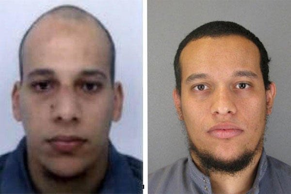 This photo provided by The Paris Police Prefecture Thursday, Jan.8, 2015 shows the suspects Cherif, left, and Said Kouachi in the newspaper attack. (AP Photo/Prefecture de Police de Paris)
