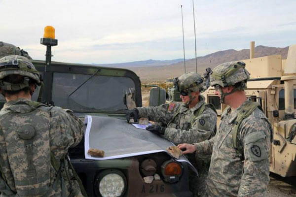 Soldiers conduct an area analysis using a map during Decisive Action Rotation 15-03 at the National Training Center at Fort Irwin, Calif., Jan. 28, 2015.(U.S. Army photo)