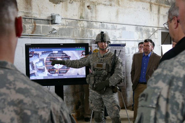 1st Lt. Cole W. Holland demonstrates the Maneuver Aviation Fires Integrated Application at the Army Expeditionary Warfighter Experiments on Fort Benning, Ga., March 3, 2015. (U.S. Army photo: Kelly Ann DeWitt)