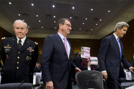 Gen. Martin Dempsey, Defense Secretary Ash Carter, and Secretary of State John Kerry, arrive on Capitol Hill, Wednesday, March 11, 2015, to testify before the Senate Foreign Relation Committee. (AP Photo/Pablo Martinez Monsivais)