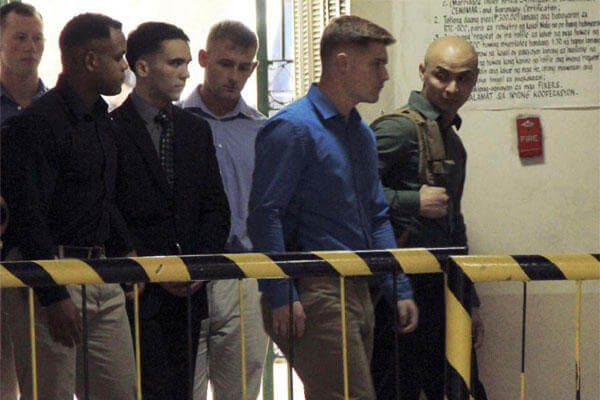 U.S. Marine Pfc. Joseph Scott Pemberton, third left, the suspect in the killing of Filipino transgender Jennifer Laude is escorted into the courtroom for his trial Monday, March 23. (AP Photo/Jun Dumaguing)