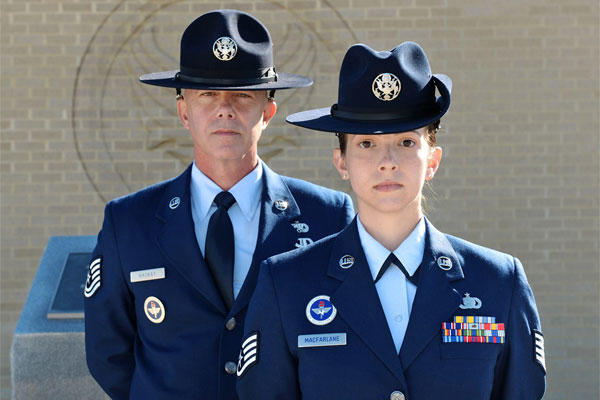Tech. Sgt. James MacKay and his daughter, Staff Sgt. Amanda MacFarlane, 433rd Training Squadron military training instructors, pose for a photo on March 27, 2015, at Joint Base San Antonio-Lackland, Texas. (U.S. Air Force photo/Benjamin Faske)