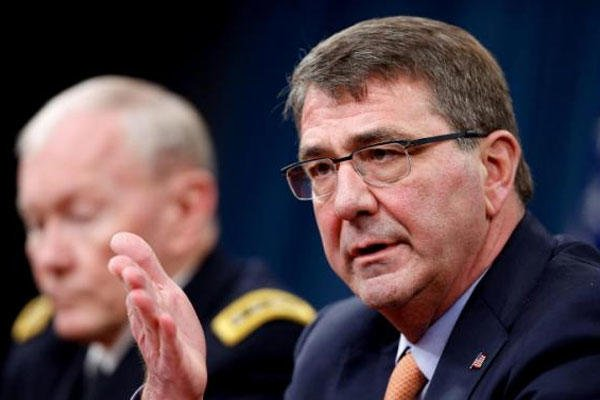 Defense Secretary Ash Carter, right, accompanied by Joint Chiefs Gen. Martin Dempsey, speaks during a news conference at the Pentagon, Thursday, April 16, 2015. (AP Photo/Andrew Harnik)
