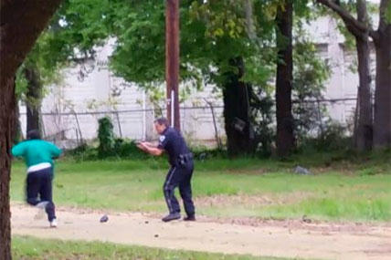 In this April 4, 2015, frame from video provided by Attorney L. Chris, Scott appears to be running away from City Patrolman Michael Thomas Slager, right, in North Charleston. (AP Photo/Courtesy of L. Chris Stewart)