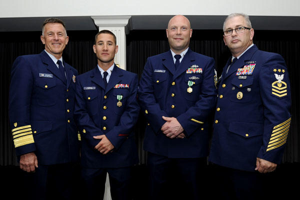Adm. Paul Zukunft, Coast Guard commandant, Petty Officer 2nd Class Giacomo Terrizzi, Chief Petty Officer Ryan Olson, and Master Chief Petty Officer of the Coast Guard Steven Cantrell, May 7, 2015. (U.S. Coast Guard photo/Chief Petty Officer Kyle Niemi)