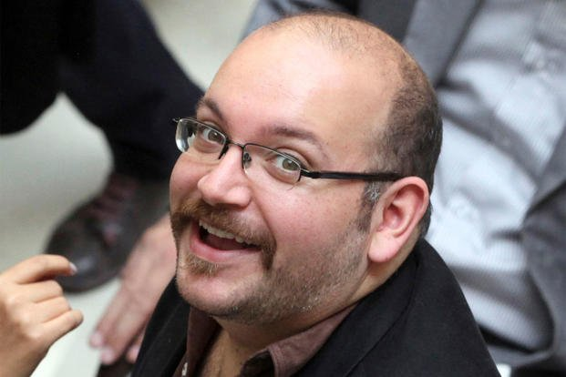 In this photo April 11, 2013 file photo, Jason Rezaian, an Iranian-American correspondent for the Washington Post, smiles as he attends a presidential campaign of President Hassan Rouhani, in Tehran, Iran. (AP Photo/Vahid Salemi, File)