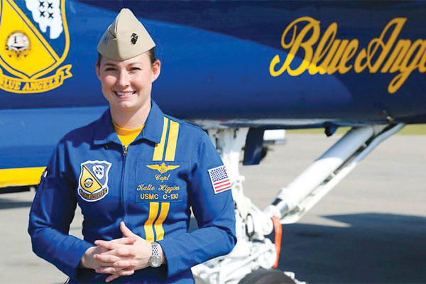 Marine Capt. Katie Higgins, the first female pilot with the U.S. Navy Flight Demonstration Squadron, or Blue Angels, speaks with media aboard Marine Corps Air Station, April 9, 2015. (U.S. Marine Corps photo by Lance Cpl. Olivia G. Ortiz/Released)