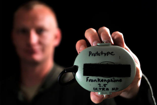 "Staff Sgt. Marion, a 42nd Attack Squadron sensor operator, displays his invention, the ""Frankenphone 3.5 Ultra High Definition,"" March 24, 2015, at Creech Air Force Base, Nev. (U.S. Air Force photo/Airman 1st Class Christian Clausen)"