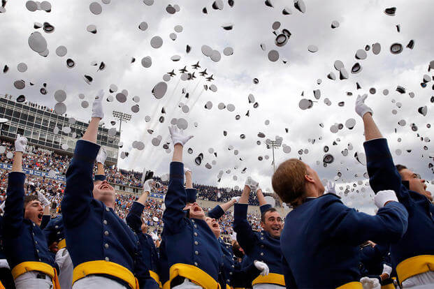Air Force Academy graduates throw their caps into the air as F-16 jets from the Thunderbirds make a flyover, at the completion of the graduation ceremony for the class of 2015, at the U.S. Air Force Academy, May 28, 2015. (AP Photo/Brennan Linsley, File)