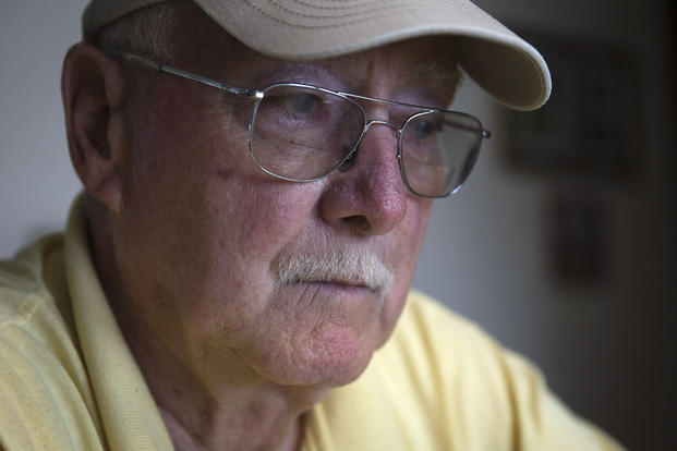 Retired Air Force reserve Tech Sgt. Ed Kienle, 73, pauses during an interview about Agent Orange exposure at his home, Thursday, June 11, 2015, in Wilmington, Ohio. John Minchillo/AP