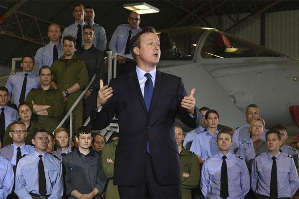 Britain's Prime Minister David Cameron addresses Royal Air Force airmen and officers during a visit to RAF Coningsby England Monday July 13, 2015. (Joe Giddens/PA via AP)