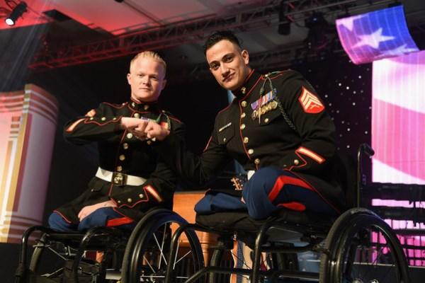 Cpl. Justin Gaertner and Sgt. Gabriel Martinez in their dress blues bumped fists as they did in Afghanistan and in recovery. (Source: ICE)