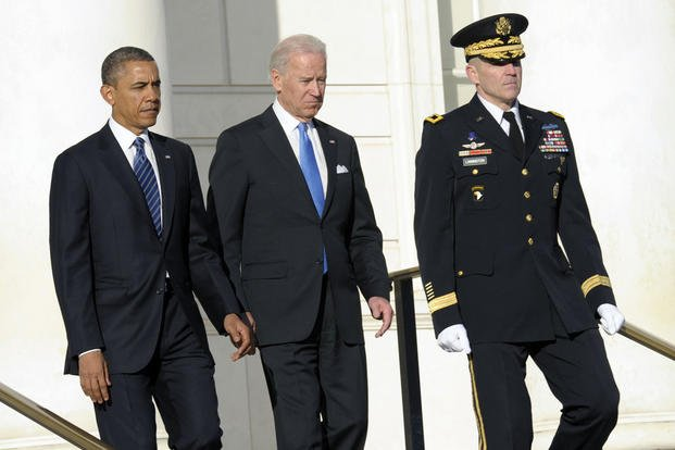In this 2013 file photo, President Barack Obama and Vice President Joe Biden, accompanied by then-Maj. Gen. Michael S. Linnington, arrive to place a wreath at the Tomb of the Unknowns at Arlington National Cemetery in Arlington, Va. Susan Walsh/AP
