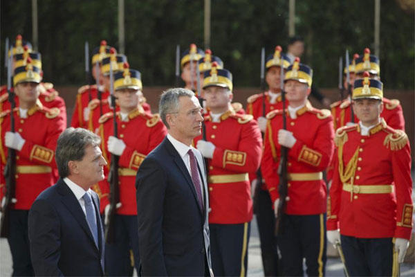 NATO Secretary General Jens Stoltenberg, right, and Romanian defense minister Mircea Dusa, left, review a honor guard in Bucharest, Romania, Thursday, July 2, 2015. (AP Photo/Vadim Ghirda)