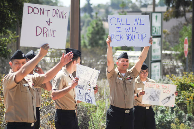 Sailors assigned to Naval Medical Center San Diego hold signs encouraging other Sailors to not drink and drive. (U.S. Navy photo by Mass Communication Specialist 3rd Class Pyoung K. Yi/Released)
