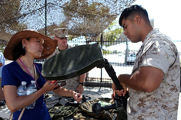 An explosive ordnance disposal Marine explains how a metal detector works to an onlooker during San Diego Fleet Week 2015 at Naval Base Coronado, Calif., Sept. 20, 2015. (U.S. Marine Corps/Sgt. Laura Gauna)