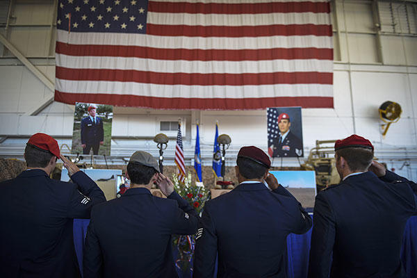 Airmen salute during Capt. Matthew D. Roland and Staff Sgt. Forrest B. Sibley's memorial service, Sept. 14, 2015, at Hurlburt Field, Fla. (U.S. Air Force/Senior Airman Ryan Conroy)
