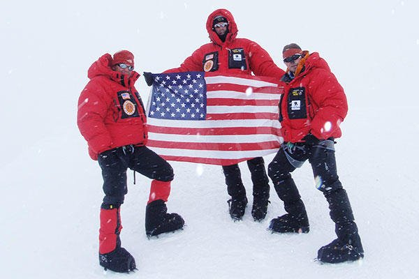 Shown at the summit of Alaska's Mount McKinley are Col. Marc Hoffmeister, his friend Bob Haines, and Army Spc. Dave Shebib in 2009.  (U.S. Army photo)