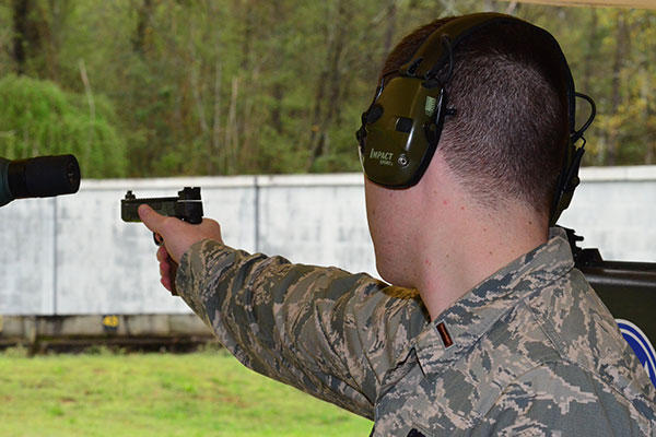 Second Lt. Tucker Sears, the 436th Logistics Readiness Squadron material management officer in charge, shoots a .22-caliber pistol during Team Camp March 24, 2015, at Fort Benning, Ga. (U.S. Air Force/Lt. Col. Hugh M. Ragland)