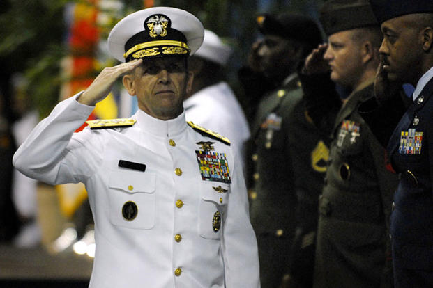 U.S Navy Adm. Eric Olson salutes after taking over as the eighth commander of U.S. Special Operations Command in a ceremony presided over by Secretary of Defense Robert Gates at the Tampa Convention Center. (U.S. Air Force photo)