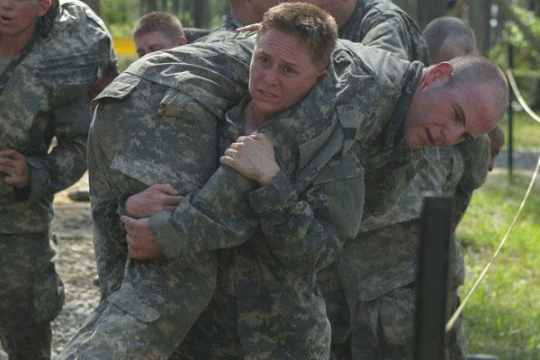 Maj. Lisa A. Jaster, 37, carries a fellow soldier during the Darby Queen obstacle course at Ranger School at Fort Benning, Ga., April 26, 2015. (U.S. Army)